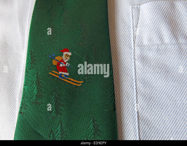 Interesting vintage tie, male neckware in silk, Santa skiing - Stock Image