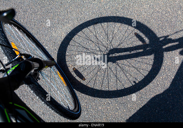 Bicycle wheel shadow - Stock-Bilder