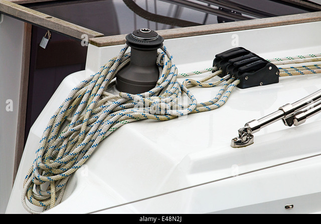 Detail shot of a winch on a yacht or sail boat great concept for leisure boating - Stock Image
