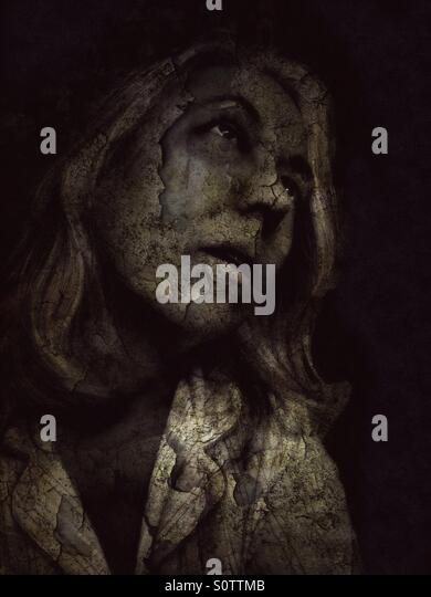 Portrait of a Woman Looking skyward With grunge - Stock Image