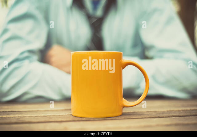 Man at table and drinking coffee - Stock Image