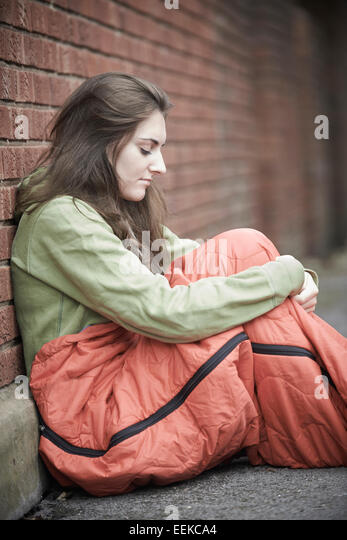 Vulnerable Teenage Girl Sleeping On The Street - Stock Image