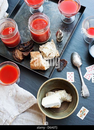 Tray of juice, bread and cheese - Stock Image