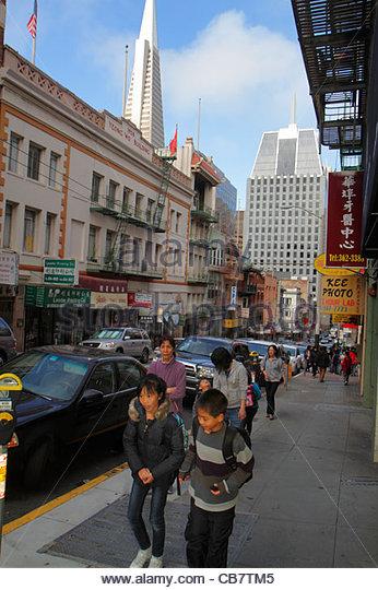 California San Francisco Chinatown ethnic neighborhood Clay Street sidewalk Asian woman boy girl family sibling - Stock Image