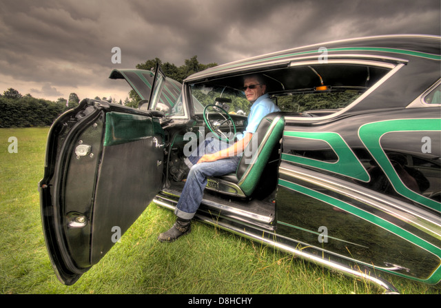 Black & Green 1957 Buick classic car ; Dave Weatherby with his award winning American 1957 classic car - Stock Image