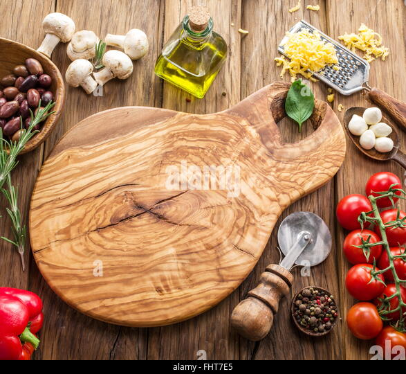 Pizza ingredients: mushrooms, olives, cheese and tomatoes. - Stock Image