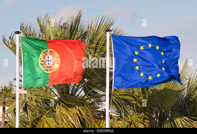 Flags or Portugal and the EEC flying together - Stock Image