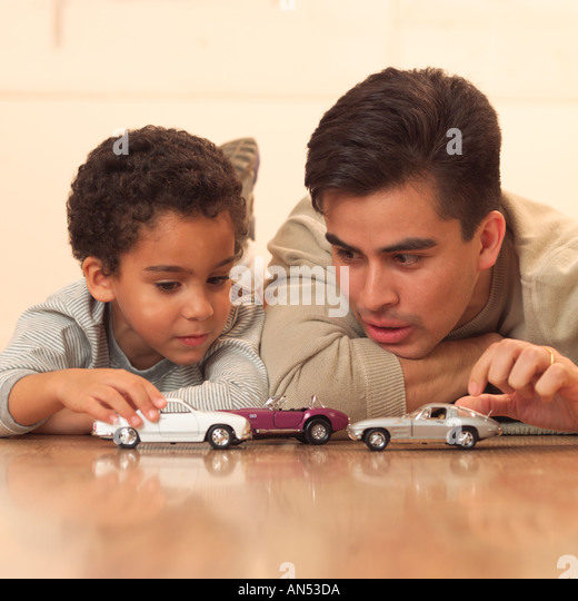 Father and son playing together - Stock Image