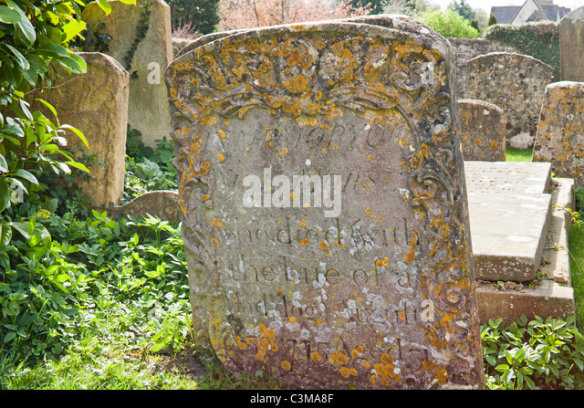 Grave in a Cotswold churchyard of Will Morse aged 31 who 'died with the bite of a mad dog' in 1775, Northleach, - Stock Image