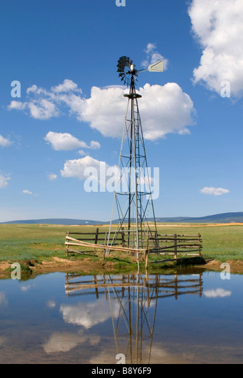 Reflection of an industrial windmill in water, Wyoming, USA - Stock Image