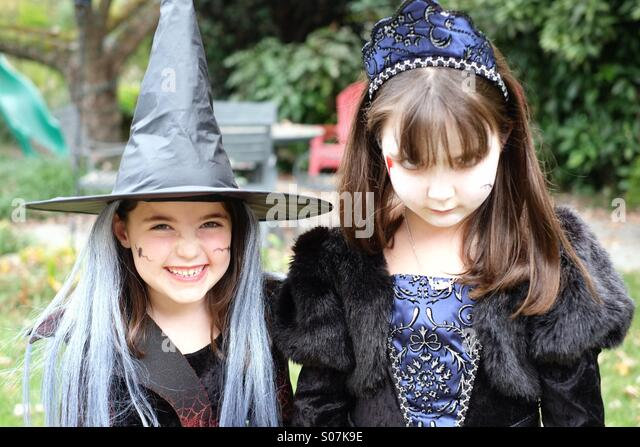 Two spooky little girls acting the part for Halloween - Stock Image