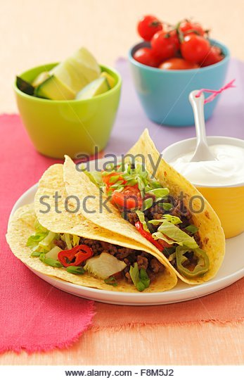 Beef, tomato and black bean burritos - Stock Image