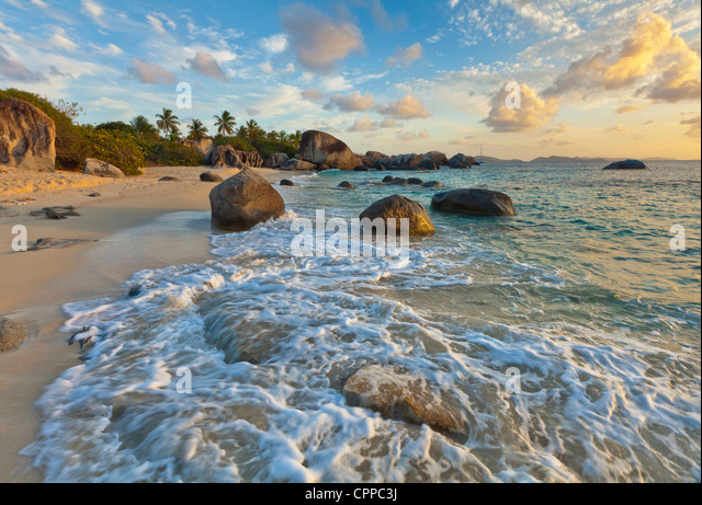 Virgin Gorda, British Virgin Islands, Caribbean Evening light on the surf and rock patterns on the beach of Little - Stock Image