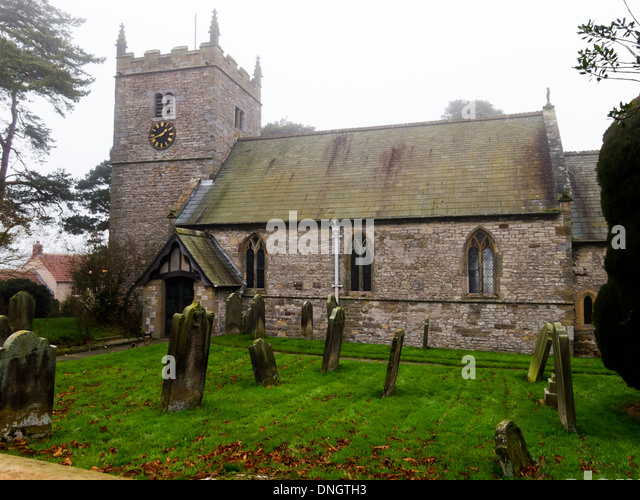 Grade 1 listed church and graveyard of All Saints and St James in Nunnington North Yorkshire England UK - Stock Image