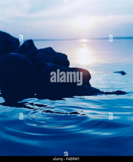 blue calmness cliff color image harmony morning nature sea silence stone summer sunrise vertical water water surface - Stock-Bilder