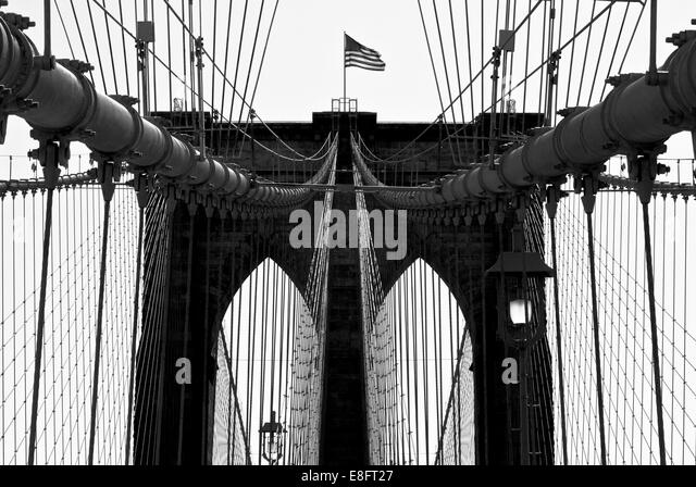 USA, New York City, Manhattan, Close up of Brooklyn Bridge with flag - Stock-Bilder