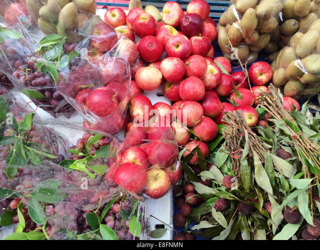Fruits on market stall - Stock Image