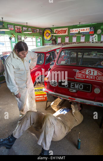 Mechanics at work on the 1963 Works BMC Mini Cooper S, 8 EMO, in the garage. 2014 Goodwood REvival, Sussex, UK. - Stock Image