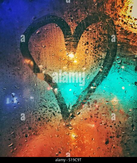 A love heart sign on the window of a bus - Stock Image