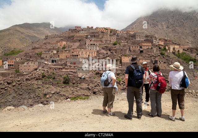 walkers in the High Atlas mountains, at the village of Aremd, Morocco Africa, concept of Adventure travel - Stock-Bilder