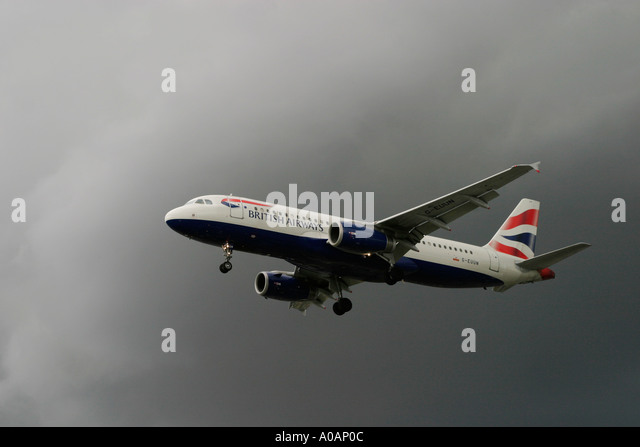 British Airways Airbus A320 flying in a bad weather condition London Heathrow UK - Stock Image