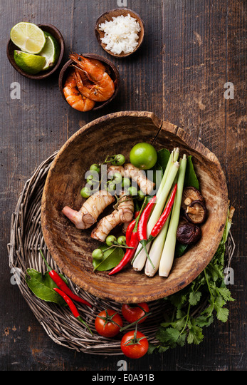 Ingredients for spicy Thai soup Tom Yam with Coconut milk, Chili pepper and Seafood - Stock Image