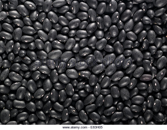 A bed of Organic Plant Based & Vegetarian Black Beans shot as textures as backgrounds - Stock Image