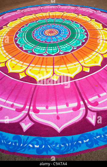 Multicoloured Indian Lotus pattern painted on the streets of Puttaparthi, Andhra Pradesh, India - Stock-Bilder