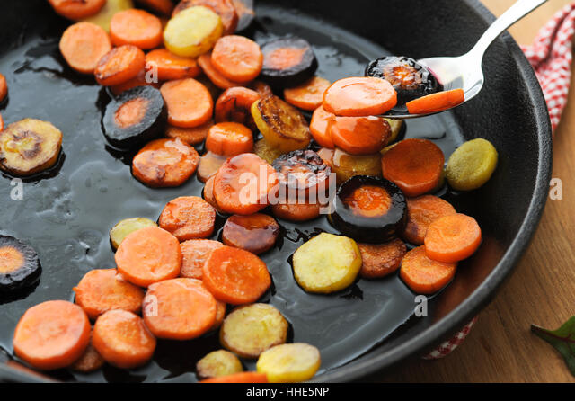 Honey glazed butter fried carrot - Stock Image