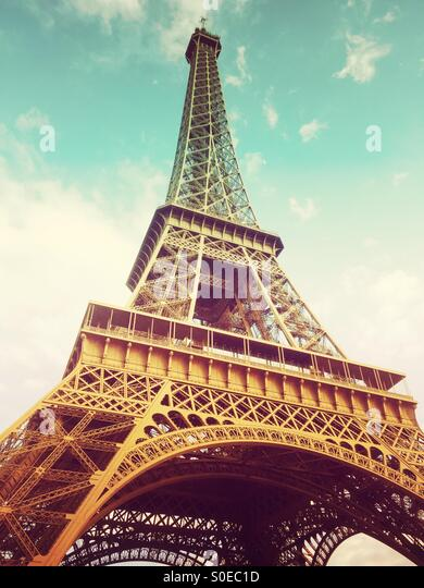 View of Eiffel Tower from below, along Champs de Mars in Paris, France. Warm, retro tones. - Stock Image