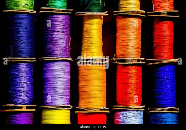 a colourful show of cotton reels - Stock Image