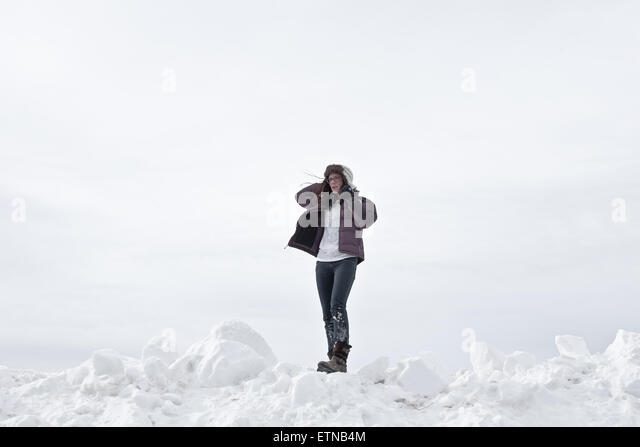 woman standing in snow, Wyoming, USA - Stock Image