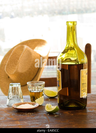 Bottle and glass of Tequila - Stock Image