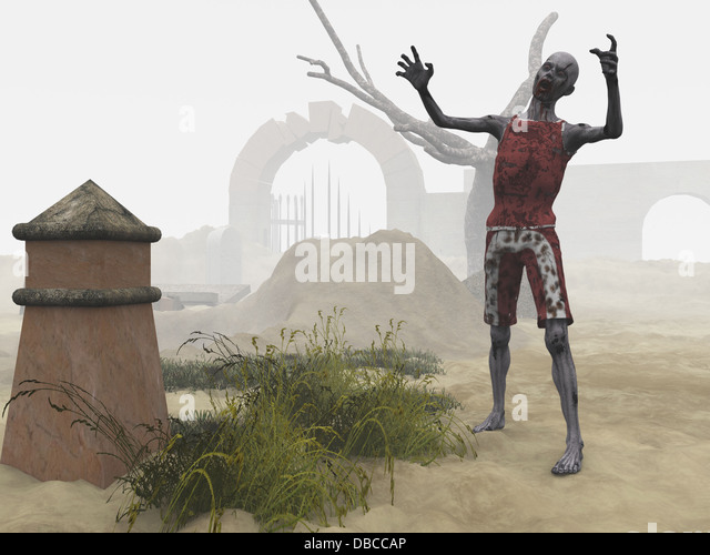 Zombie in misty graveyard - Stock Image