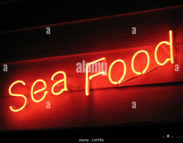 NEON SIGN - Sea Food - Stock Image
