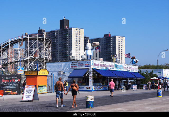 the background overview of the famous coney island Overview top experiences new york new york city family top 5 new york city activities for manhattan skyline in the background 2 coney island.