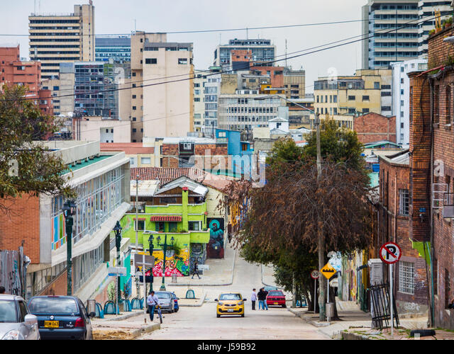 A taxi drives up the hill in La Candelaria, Bogota, Colombia - Stock Image