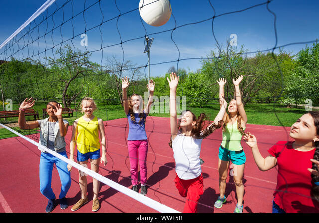 Volleyball game with playing teenage children - Stock Image