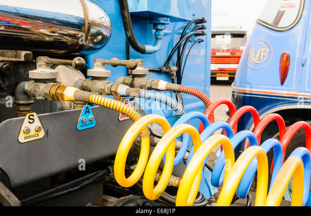 Pneumatic hoses connecting a front cab to the rear trailer of an articulated lorry - Stock Image