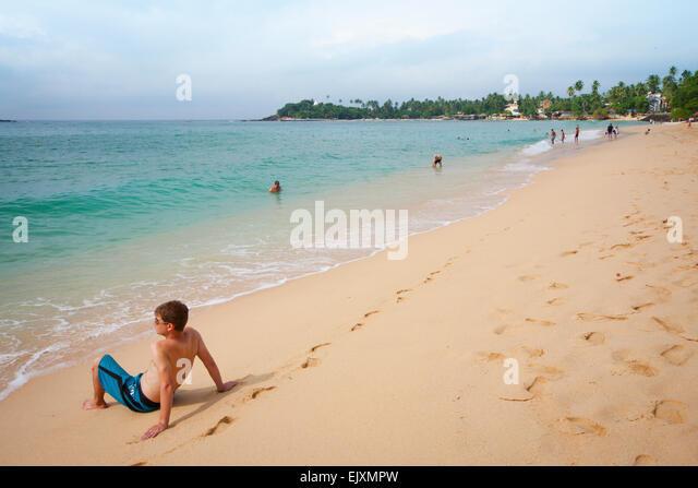 TOURIST ON UNAWATUNA BEACH - Stock Image