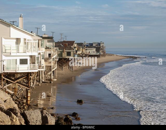A row of beach front homes enjoying the warm California sun. - Stock Image