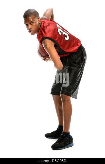 African American basketball player isolated over white background - Stock Image