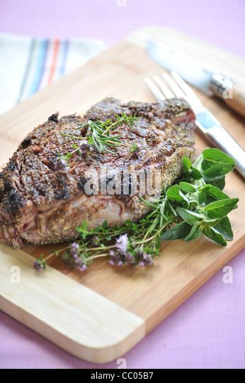Rib Roast Beef in Herbs Crust - Stock Image