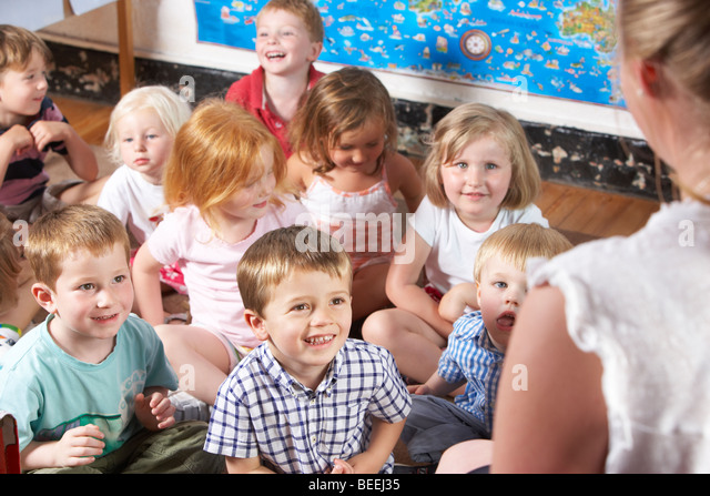 Young Girl Playing at Montessori/Pre-School - Stock Image
