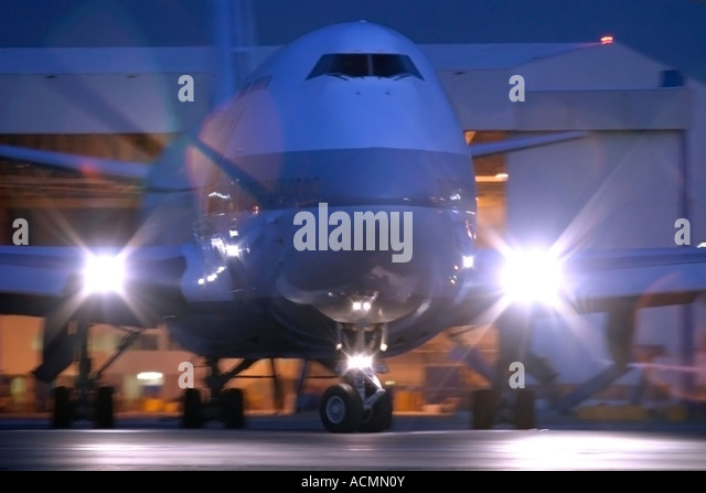 Airliner taxiing for departure at night - Stock Image