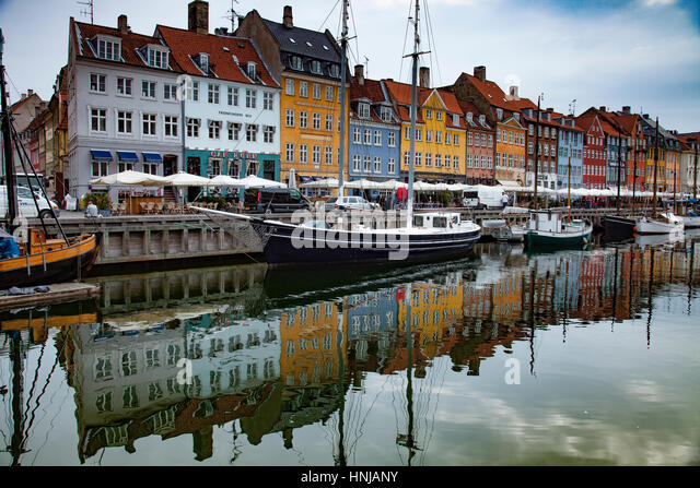 Colorful buildings in Nyhavn, Copenhagen, Denmark,!7th century waterfront village Canals reflect multi-colored storefronts - Stock-Bilder