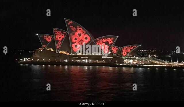Sydney, Australia. 11th Nov, 2016. Sydney Opera House seen covered in light projected poppies for Remembrance Day. - Stock Image