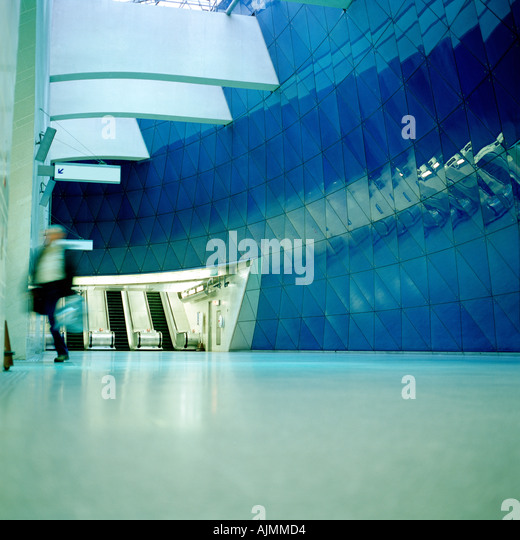 Businessman running in entrance hall - Stock Image
