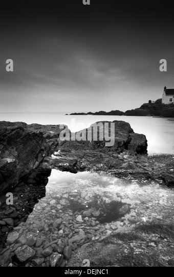 Moody shot of St Brides bay in Pembroke, West Wales, UK ,with rocky foreshore and calm sea - Stock-Bilder