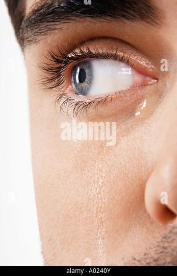 Man's eye, crying - Stock Image